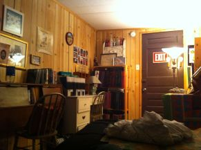 My room in his hostel was full of essays and photo albums.