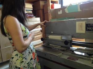 Dina testing her skills on the gluer, making us some blank poetry books!