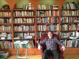 Andy in front of his personal library.
